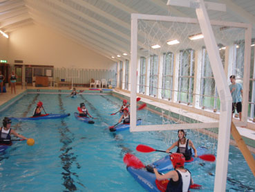 Canoe Polo indoors in a swimming pool