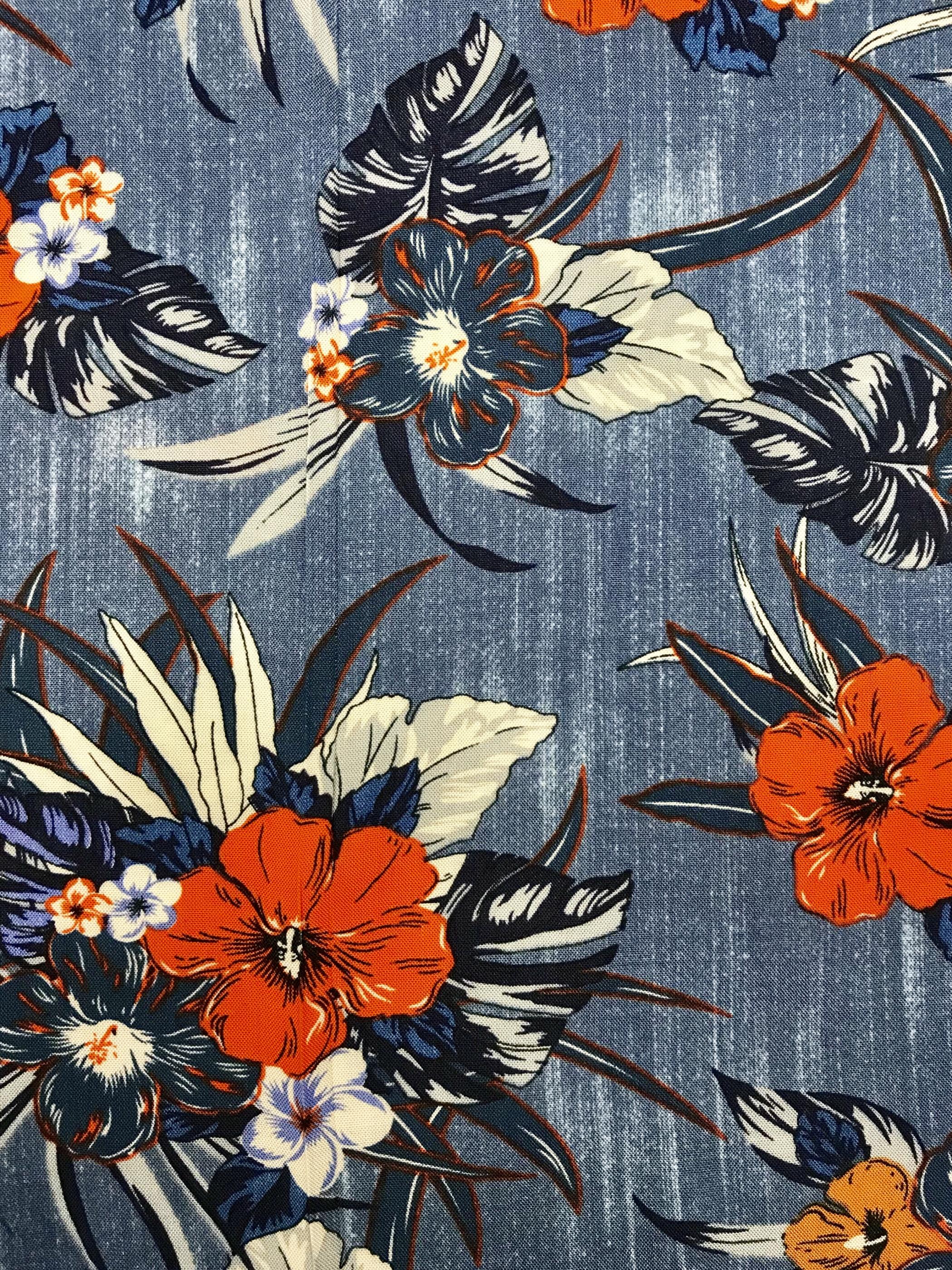 tyg metervara röd orange blå blommor