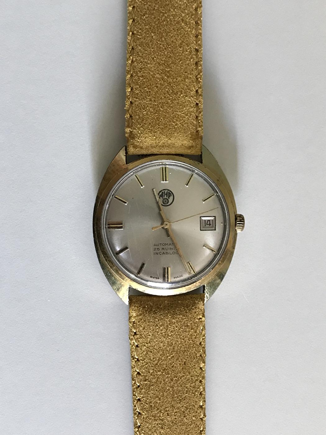Kundbild - Guldband på gammal föreningsklocka