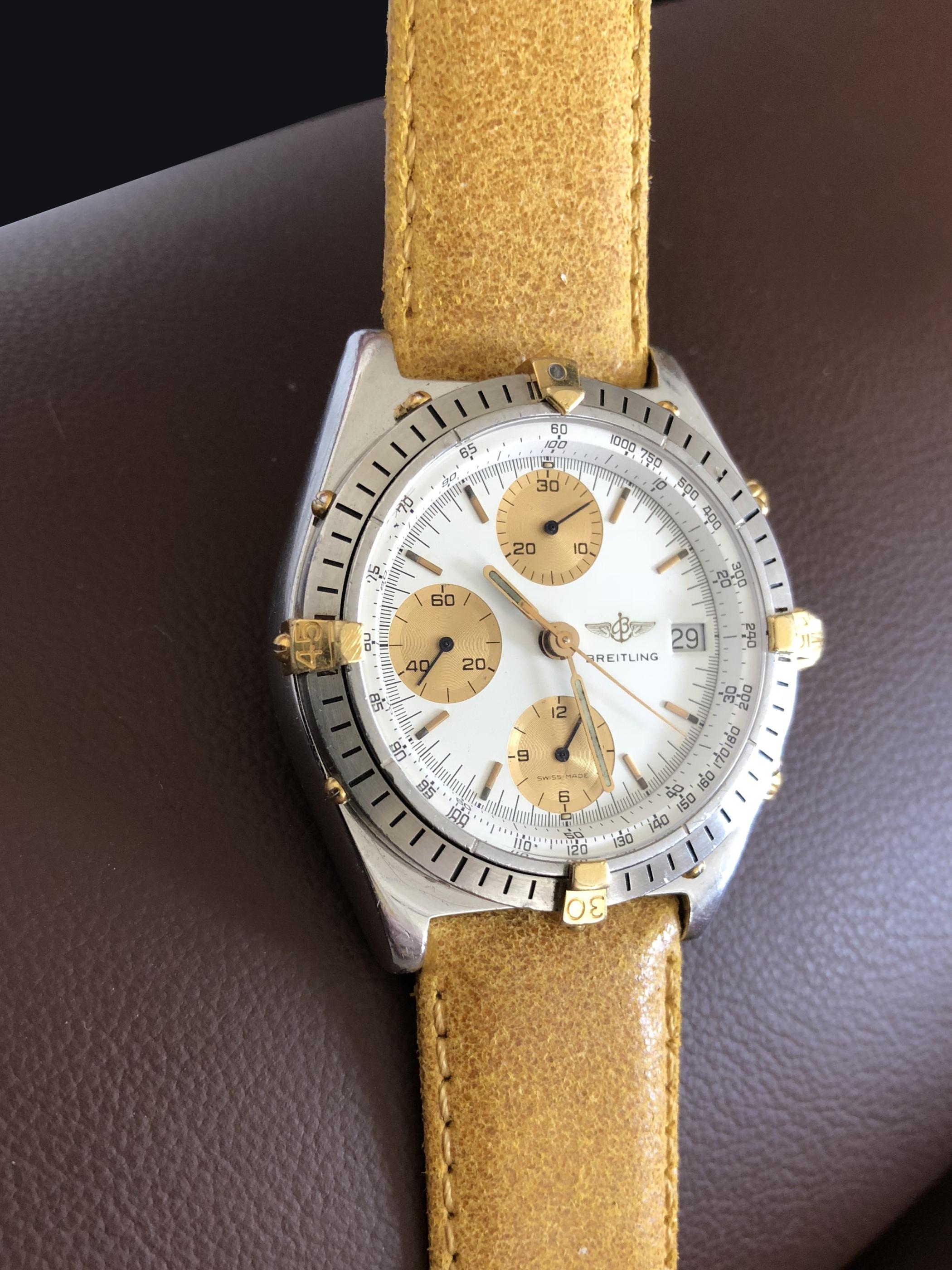 Guldband på Breitling